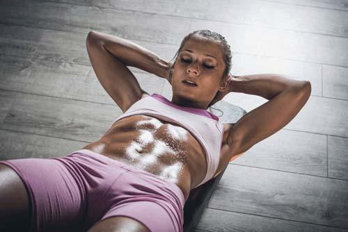 Female on the floor doing ab exercises