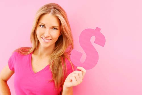 Attractive woman wearing a pink shirt holding a pink dollar sign