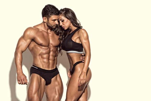 Super fit male and female standing together
