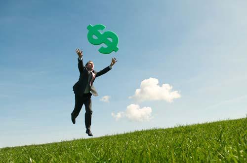 Businessman Chasing Success in Green Dollar Meadow