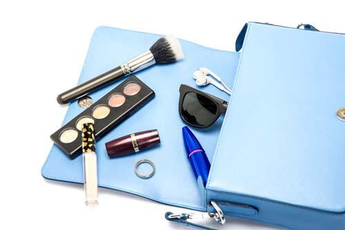 Blue purse with makeup inside