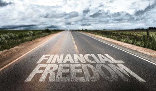 """""""Financial Freedom"""" written on a road"""