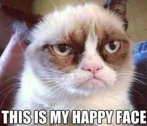 """Grumpy Cat meme with """"This is my happy face"""" text at bottom"""