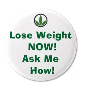 """A Herbalife pin that says """"Lose Weight Now! Ask Me How!"""""""