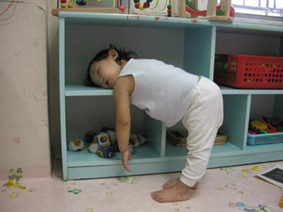 young child sleeping while standing