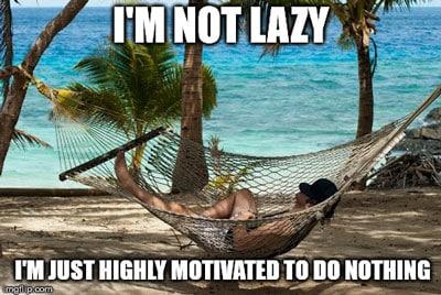man lying in a hammock on the beach